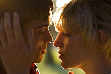 A passionate young couple face to face, extreme close up