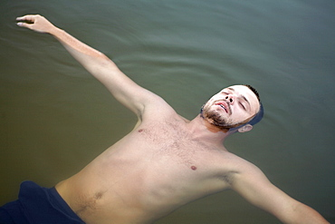Man floating on water