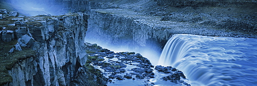 High angle view of waterfall from rocky cliff, Dettifoss, Iceland