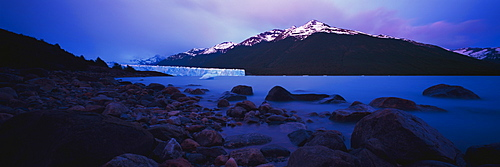 Idyllic shot of glacier in lake with mountain against sky, Patagonia, Argentina