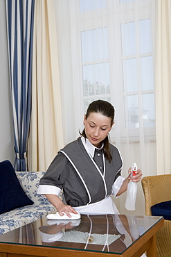 Uniformed main cleaning table in hotel room