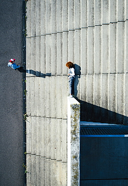 View from above young man laying on urban steps