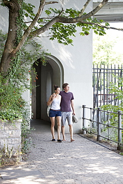 Young couple walking through pavement