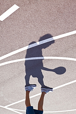 Man playing basketball, low section