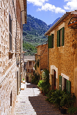 Sunny cobblestone street and houses, Fornalutx, Mallorca, Balearic Islands, Spain