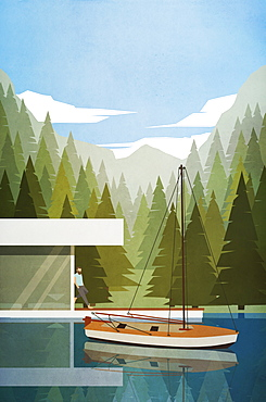 Man relaxing at modern lakeside house with boat