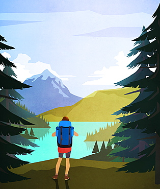 Female hiker enjoying scenic lake and mountain view