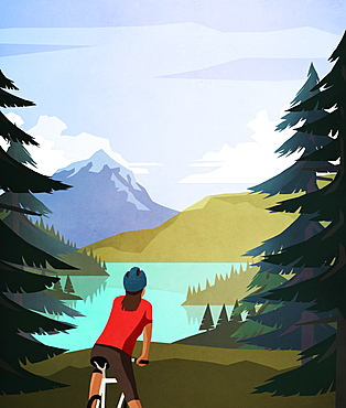 Female mountain biker looking at idyllic, tranquil mountain lake view