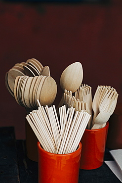Bamboo fork, spoon and chopstick utensils in crocks
