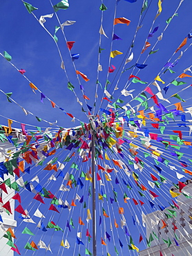 Vibrant multicoloured flags against sunny blue sky