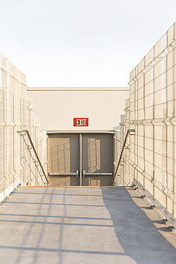 Exit sign above double doors on rooftop