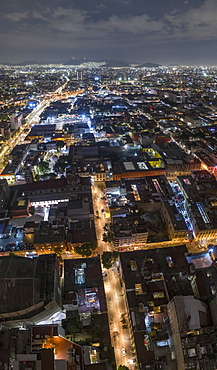 Aerial view Mexico City illuminated at night, Mexico
