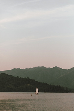 Sailboat on tranquil Whiskeytown Lake, Redding, California, USA