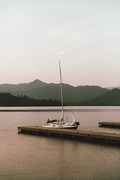Sailboat moored at dock on tranquil Whiskeytown Lake, Redding, California, USA