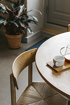 Tea and teacup on wooden dining table