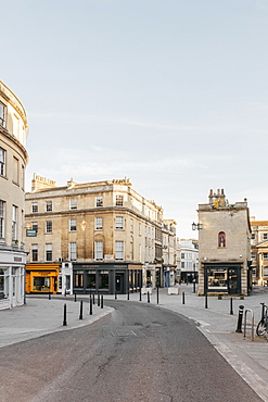 Buildings along empty curving road, Bath, Somerset, UK