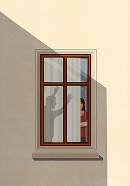 Shadow of angry man gesticulating at woman in apartment window