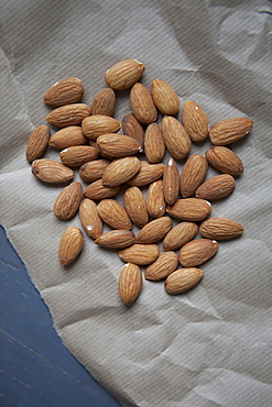 Close-up of almonds on paper
