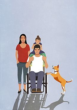 Portrait happy man in wheelchair with family and dog
