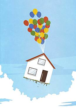 Helium balloons lifting house into sky