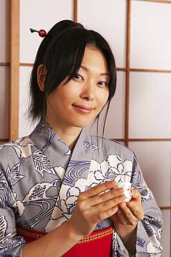 Portrait beautiful young woman in Japanese kimono with tea