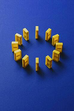 Yellow dominos forming European Union flag on blue background