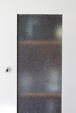 Closed cabinet door with frosted glass