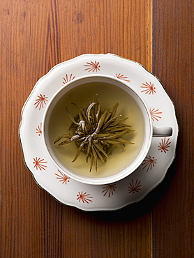 Directly above shot of herbal tea on wooden table