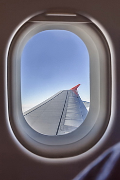 View of aircraft wing through window