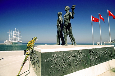 Statues at a monument with flags of Turkey, Monument of Ataturk and Youth, Kusadasi, Turkey
