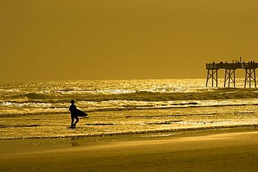 Silhouette of a person walking on the beach, Daytona Beach, Florida, USA