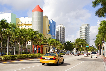 Cars on the road with buildings in the background, South Beach, Miami Beach, Florida, USA