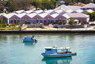 Tourboats in water in front of buildings, Paradise Island, Bahamas