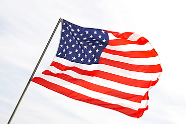 Low angle view of an American flag fluttering, USA