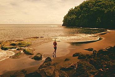High angle view of a woman running on the beach, Tahiti, Society Islands, French Polynesia