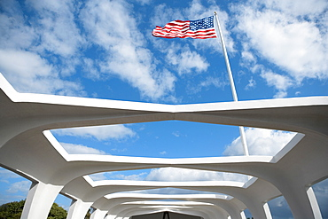 Low angle view of an American flag fluttering on a memorial building, USS Arizona Memorial, Pearl Harbor, Honolulu, Oahu, Hawaii Islands, USA