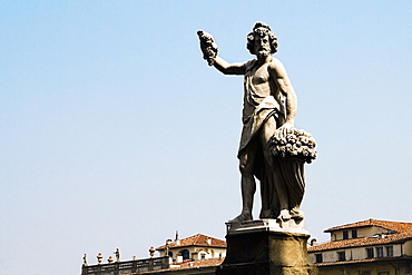 Low angle view of a statue, Ponte Santa Trinita Bridge, Florence, Tuscany, Italy
