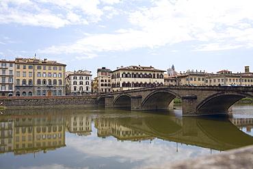 Reflection of an arch bridge in water, Ponte Santa Trinita Bridge, Arno River, Florence, Italy