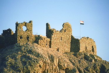 Low angle view of a flag at a ruined castle, Crusader Fort, Israel