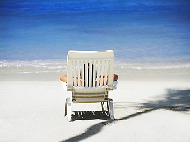 Rear view of a person lying on a lounge chair on the beach, South West Bay, Providencia, Providencia y Santa Catalina, San Andres y Providencia Department, Colombia