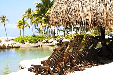 Deck chairs on the beach, Cancun, Mexico