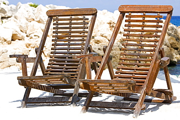 Two deck chairs on the beach, Cancun, Mexico
