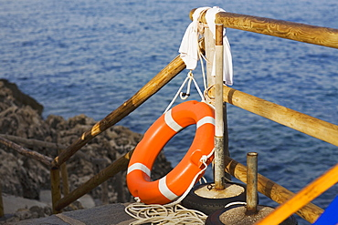 Life belt near a wooden railing, Capri, Campania, Italy