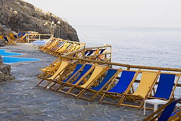 Deck chairs in a row, Capri, Campania, Italy