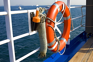 Life belt tied on the railing of a boat, Athens, Greece