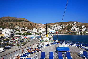 High angle view of lounge chairs on the deck of a ship, Skala, Patmos, Dodecanese Islands, Greece