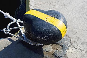 Close-up of ropes tied around a bollard