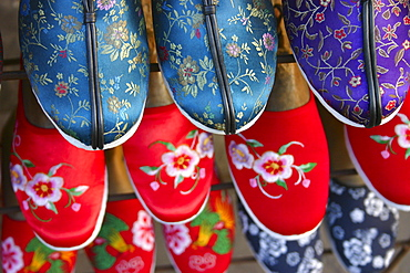 High angle view of embroidery slippers in racks, Beijing, China