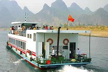 Tourists on a tourboat, Li River, Guilin, China