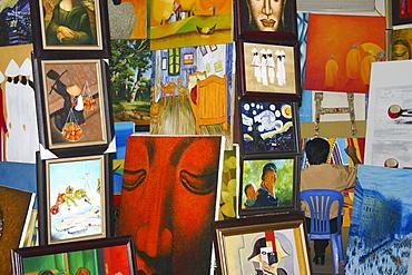 Painter with his paintings, Hanoi, Vietnam